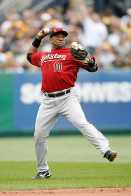 PITTSBURGH - APRIL 13:  Miguel Tejada #10 of the Houston Astros fields the ball during the Opening Day game against the Pittsburgh Pirates at PNC Park on April 13, 2009 in Pittsburgh, Pennsylvania.  (Photo by: Gregory Shamus/Getty Images)