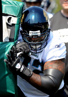 JACKSONVILLE, FL - MAY 1:  Tackle Tra Thomas #72 of the Jacksonville Jaguars pushes a blocking sled May 1, 2009 at a team minicamp near Jacksonville Municipal Stadium in Jacksonville, Florida.  (Photo by Al Messerschmidt/Getty Images)