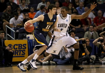 PHOENIX - MARCH 27:  Joe Alexander #11 of West Virginia Mountaineers dribbles the ball past Derrick Brown #5 of the Xavier Musketeers in the West Regional Sweet 16 game at the U.S. Airways Center on March 27, 2008 in Phoenix, Arizona.  (Photo by Stephen D