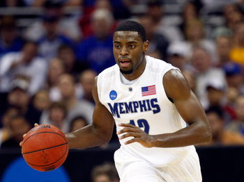 KANSAS CITY, MO - MARCH 21:  Tyreke Evans #12 of the Memphis Tigers dribbles the ball during their second round game against the Maryland Terrapins in the NCAA Division I Men's Basketball Tournament at the Sprint Center on March 21, 2009 in Kansas City, M