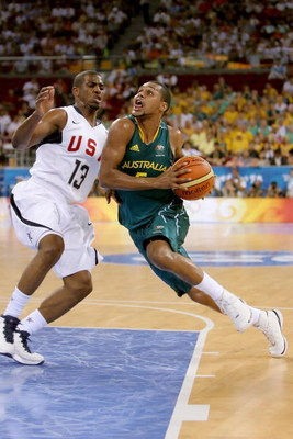 BEIJING - AUGUST 20:  Patrick Mills #5 of Australia drives to the basket over Chris Paul #13 of the United States during the men's basketball quarterfinal game at the Olympic Basketball Gymnasium during Day 12 of the Beijing 2008 Olympic Games on August 2