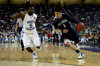 DETROIT - APRIL 04:  Scottie Reynolds #1 of the Villanova Wildcats drives in the second half against Ty Lawson #5 of the North Carolina Tar Heels during the National Semifinal game of the NCAA Division I Men's Basketball Championship at Ford Field on Apri