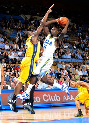 WESTWOOD, CA - JANUARY 29:  Jrue Holiday #21 of the UCLA Bruins scores on a layup against Theo Robertson #24 of the University of California Golden Bears during the second half at Pauley Pavilion on January 29, 2009 in Westwood, California. UCLA won, 81-6