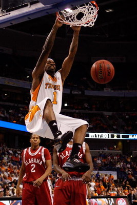 TAMPA, FL - MARCH 13:  Tyler Smith #1 of the Tennessee Volunteers dunks the ball over Mikhail Torrance #2 of the Alabama Crimson Tide during the quaterfinal round of the SEC Men's Basketball Tournament on March 13, 2009 at The St. Pete Times Forum in Tamp