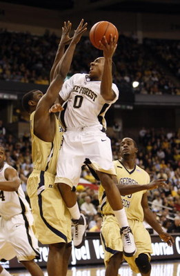 WINSTON-SALEM, NC - FEBRUARY 18:  Jeff Teague #0 of the Wake Forest Demon Deacons jumps to the basket for a lay up during their game against the Georgia Tech Yellow Jackets at Lawrence Joel Coliseum on February 18, 2009 in Winston-Salem, North Carolina. T