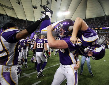 MINNEAPOLIS - DECEMBER 28:   Ryan Longwell #8 of the Minnesota Vikings is carried by Cullen Loeffler #46 after Longwell kicked the game winning field goal with five seconds left in the game against the New York Giants on December 28,2008 at the Hubert H.