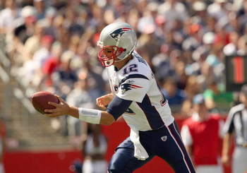 FOXBORO, MA - SEPTEMBER 7:  Quarterback Tom Brady #12 of the New England Patriots looks to hand off the ball during their NFL game against the Kansas City Chiefs on September 7, 2008 at Gillette Stadium in Foxboro, Massachusetts. The Patriots defeated the