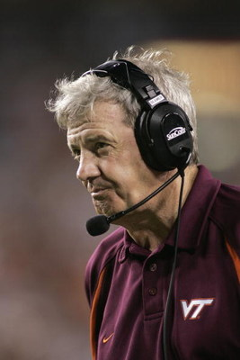 LANDOVER, MD - AUGUST 28:  Head Coach Frank Beamer of the Virginia Tech Hokies looks on against the University of Southern California Trojans during the Black Coaches Association Football Classic on August 28, 2004 at FedEx Field in Landover, Maryland.  U