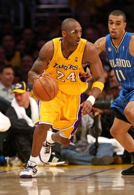 LOS ANGELES - JANUARY 16:  Kobe Bryant #24 of the Los Angeles Lakers dribbles the ball during their NBA game against the Orlando Magic on January 16, 2009 at Staples Center in Los Angeles, California. The Magic won 109-103.   NOTE TO USER: User expressly