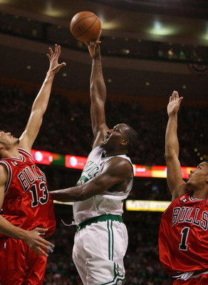 BOSTON - MAY 02:  Kendrick Perkins #43 of the Boston Celtics takes a shot over Joakim Noah #13 of the Chicago Bulls as Derrick Rose #1 of the Bulls defends in Game Seven of the Eastern Conference Quarterfinals during the 2009 NBA Playoffs at TD Banknorth