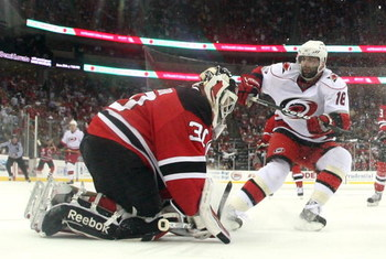 NEWARK, NJ - APRIL 28: Ryan Bayda #18 of the Carolina Hurricanes is stopped by Martin Brodeur #30 of the New Jersey Devils during Game Seven of the Eastern Conference Semifinal Round of the 2009 Stanley Cup Playoffs at the Prudential Center on April 28, 2