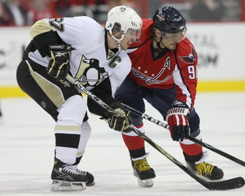WASHINGTON - MAY 13: Sergei Fedorov #91 of the Washington Capitals skates against Sidney Crosby #87 of the Pittsburgh Penguins during Game Seven of the Eastern Conference Semifinal  Round of the 2009 Stanley Cup Playoffs at Verizon Center on May 13, 2009