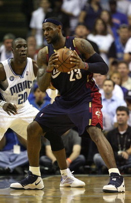 ORLANDO, FL - MAY 30:  LeBron James #23 of the Cleveland Cavaliers handles the ball against Mickael Pietrus #20 of the Orlando Magic in Game Six of the Eastern Conference Finals during the 2009 Playoffs at Amway Arena on May 30, 2009 in Orlando, Florida.