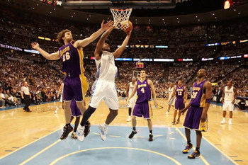 DENVER - MAY 29:  Nene #31 of the Denver Nuggets goes up for a shot over Pau Gasol #16 of the Los Angeles Lakers in Game Six of the Western Conference Finals during the 2009 NBA Playoffs at Pepsi Center on May 29, 2009 in Denver, Colorado. NOTE TO USER: U