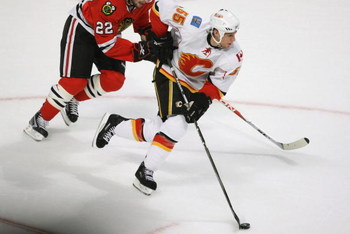 CHICAGO - APRIL 25:  Adam Pardy #55 of the Calgary Flames skates with the puck against the Chicago Blackhawks during Game Five of the Western Conference Quarterfinals of the 2009 Stanley Cup Playoffs on April 25, 2009 at the United Center in Chicago, Illi
