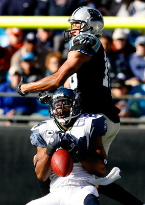 CHARLOTTE, NC - DECEMBER 16:  Strong safety Deon Grant #24 of the Seattle Seahawks nearly intercepts a pass intended for receiver Drew Carter #18 of the Carolina Panthers during the first half at Bank of America Stadium on December 16, 2007 in Charlotte,