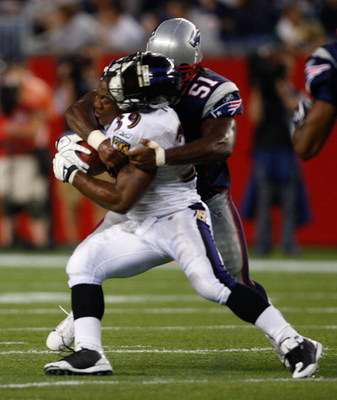 FOXBORO, MA - AUGUST 7: Ray Rice #39 of the Baltimore Ravens has his helmet knocked off as he is tackled by Jerod Mayo #51 of the New England Patriots during the preseason game at Gillette Stadium on August 7, 2008 in Foxboro, Massachusetts. (Photo by Jim