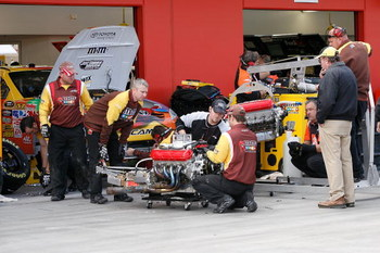 LAS VEGAS - FEBRUARY 27: Crew members for the #18 M&amp;M's Toyota driven by Kyle Busch change engines during practice for the NASCAR Sprint Cup Series Shelby 427 at the Las Vegas Motor Speedway on February 27, 2009 in Las Vegas, Nevada.  (Photo by John Harre