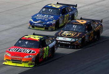 DOVER, DE - MAY 31:  Jeff Gordon, driver of the #24 DuPont Chevrolet leads David Ragan, driver of the #6 UPS Ford and Joe Nemechek, driver of the #87 Nemco Motorsports Toyota during the NASCAR Sprint Cup Series Autism Speaks 400 at Dover International Spe