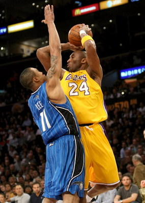 LOS ANGELES, CA - JANUARY 16: Kobe Bryant #24 of the Los Angeles Lakers throws a pass over Courtney #11 of the Orlando Magic on January 16, 2009 at Staples Center in Los Angeles, California. The Magic won 109-103. NOTE TO USER: User expressly acknowledges