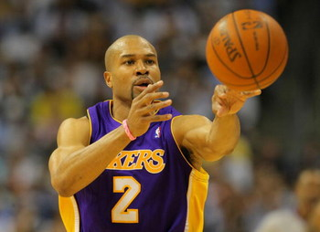 DENVER - MAY 23:  Derek Fisher #2 of the Los Angeles Lakers passes the ball against the Denver Nuggets in Game Three of the Western Conference Finals during the 2009 NBA Playoffs at Staples Center on May 23, 2009 in Denver, Colorado. NOTE TO USER: User ex