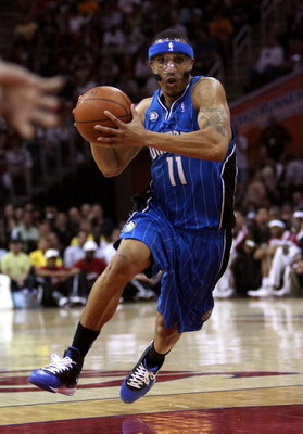CLEVELAND - MAY 22:  Courtney Lee #11 of the Orlando Magic handles the ball against the Cleveland Cavaliers in Game Two of the Eastern Conference Finals during the 2009 Playoffs at Quicken Loans Arena on May 22, 2009 in Cleveland, Ohio. NOTE TO USER: User
