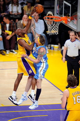 LOS ANGELES, CA - MAY 27:  Lamar Odom #7 of the Los Angeles Lakers is blocked by Chris Andersen #11 of the Denver Nuggets in the first quarter of Game Five of the Western Conference Finals during the 2009 NBA Playoffs at Staples Center on May 27, 2009 in