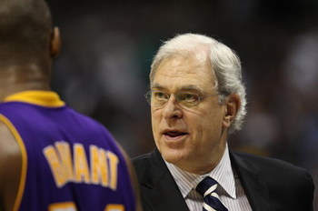 DENVER - MAY 25:  Head coach Phil Jackson of the Los Angeles Lakers coaches speaks with Kobe Bryant #24 against the Denver Nuggets in Game Four of the Western Conference Finals during the 2009 NBA Playoffs at Pepsi Center on May 25, 2009 in Denver, Colora