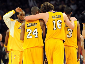 LOS ANGELES, CA - MAY 27:  Kobe Bryant #24, Pau Gasol #16, Trevor Ariza #3 of the Los Angeles Lakers embrace in the fouth quarter against the Denver Nuggets in Game Five of the Western Conference Finals during the 2009 NBA Playoffs at Staples Center on Ma