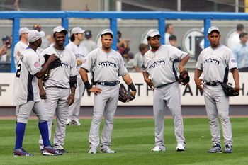 NEW YORK - JULY 14:  (L-R) National League All-Stars Hanley Ramirez #2 of the Florida Marlins, Aramis Ramirez #16 of the Chicago Cubs, Edinson Volquez #36 of the  Cincinnati Reds and Carlos Marmol #49 of the Chicago Cubs look on during batting practice fo