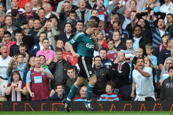 LONDON, ENGLAND - MAY 09:  Steven Gerrard of Liverpool holds his finger to his lips to silence the crowd after he scores from the rebound of his penalty during the Barclays Premier League match between West Ham United and Liverpool at Upton Park on May 9,