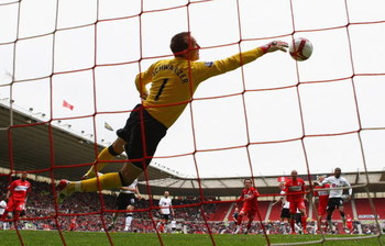 MIDDLESBROUGH, ENGLAND - APRIL 18:  Mark Schwarzer of Fulham makes a diving save against his former club during the Barclays Premier League match between Middlesbrough and Fulham at the Riverside Stadium on April 18, 2009 in Middlesbrough, England.  (Phot