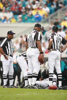 JACKSONVILLE, FL - DECEMBER 24:  Referees look on as one of them is hurt during a play between the New England Patriots and the Jacksonville Jaguars on December 24, 2006 at Alltel Stadium in Jacksonville, Florida. The Patriots defeated the Jaguars 24-21.