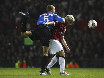 MANCHESTER, UNITED KINGDOM - OCTOBER 17:  Alan Smith of Manchester United battles with Brede Hangeland of FC Copenhagen during the UEFA Champions League Group F match between Manchester United and FC Copenhagen at Old Trafford on October 17, 2006 in Manch