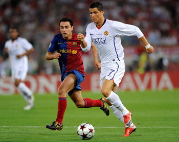 ROME, ITALY - MAY 27:  Cristiano Ronaldo (R) of Manchester United FC is tracked by Xavi Hernandez of Barcelona during the UEFA Champions League Final match between Barcelona and Manchester United at the Stadio Olimpico on May 27, 2009 in Rome, Italy.  (Ph