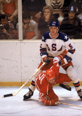 LAKE PLACID, NY - FEBRUARY 22:  Mike Ramsey #5 of the United States stands over Valeri Kharlamov #17 of the Soviet Union during the Winter Olympic Games on February 22, 1980 in Lake Placid, New York. The United States won 4-3.  (Photo by Tony Duffy/Getty