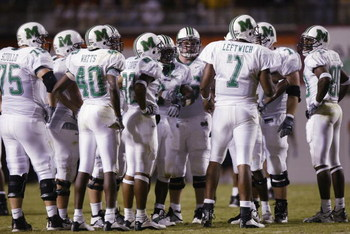 BLACKSBURG, VA - SEPTEMBER 12:  Quarterback Byron Leftwich #7 of the Marshall Thundering Herd leads the offensive huddle during the NCAA football game against the Virginia Tech Hokies at Lane Stadium on September 12, 2002 in Blacksburg, Virgina.  The Hoki