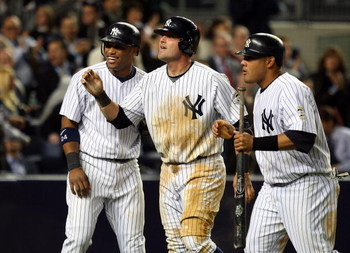 NEW YORK - MAY 19:  (L-R) Robinson Cano #24, Francisco Cervelli #29, and Melky Cabrera #53 of the New York Yankees celebrate after scoring on tammate Derek Jeter's (not pictured) double in the seventh inning against the Baltimore Orioles on May 19, 2009 a