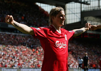 LIVERPOOL, ENGLAND - MAY 24:  Fernando Torres of Liverpool celebrates after scoring the opening goal during the Barclays  Premier League match between Liverpool and Tottenham Hotspur at Anfield on May 24, 2009 in Liverpool, England.  (Photo by Alex Livese