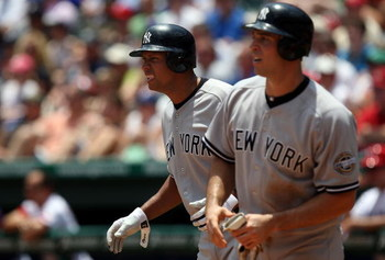 ARLINGTON, TX - MAY 25:  Alex Rodriguez and Mark Teixeira #25 of the New York Yankees celebrate after scoring against the Texas Rangers in the third inning on May 25, 2009 at Rangers Ballpark in Arlington, Texas.  (Photo by Ronald Martinez/Getty Images)