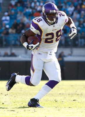 JACKSONVILLE, FL - NOVEMBER 23:  Adrian Peterson #28 of the Minnesota Vikings runs for yardage against the Jacksonville Jaguars during the game at Jacksonville Municipal stadium on November 23, 2008 in Jacksonville, Florida.  (Photo by Sam Greenwood/Getty
