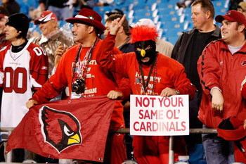 CHARLOTTE, NC - JANUARY 10:  Fans of the Arizona Cardinals hold a sign that reads 'Not Your Same Ol' Cardinals' during the game against the Carolina Panthers during the NFC Divisional Playoff Game on January 10, 2009 at Bank of America Stadium in Charlott