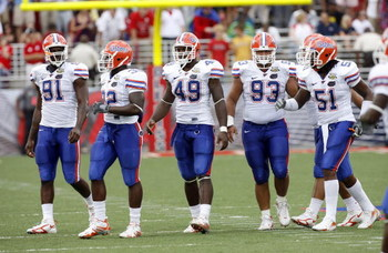 OXFORD, MS - SEPTEMBER 22: Derrick Harvey #91, Dustin Doe #32, Jermaine Cunningham #49, Javier Estopinan #93 and Brandon Spikes #51 of the Florida Gators get set on defense against the Mississippi Rebels on September 22, 2007 at Vaught-Hemingway Stadium/H