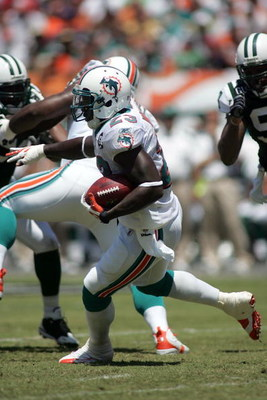 MIAMI - SEPTEMBER 07:  Ronnie Brown #23 of the Miami Dolphins runs the ball against the New York Jets at Dolphin Stadium on September 7, 2008 in Miami, Florida. The Jets won 20-14. (Photo by Marc Serota/Getty Images)