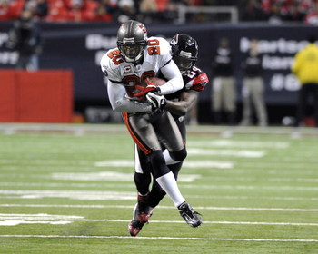 ATLANTA - DECEMBER 14:  Cornerback Ronde Barber #20 of the Tampa Bay Buccaneers intercepts a second-quarter pass against the Atlanta Falcons at the Georgia Dome on December 14, 2008 in Atlanta, Georgia.  (Photo by Al Messerschmidt/Getty Images)