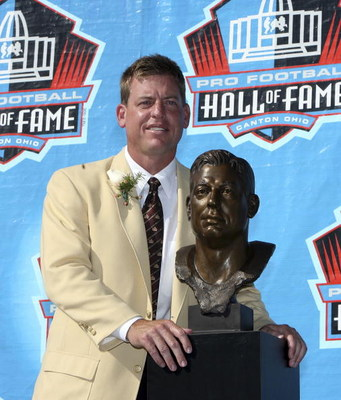 CANTON, OH - AUGUST 05:  Quarterback Troy Aikman of the Dallas Cowboys poses with his bust after his induction during the Class of 2006 Pro Football Hall of Fame Enshrinement Ceremony at Fawcett Stadium on August 5, 2006 in Canton, Ohio.  (Photo by Doug B