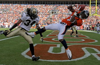 DENVER - SEPTEMBER 21:  Wide receiver Eddie Royal #19 of the Denver Broncos is unable to stay inbounds as he makes a reception in the endzone as corner back Mike McKenzie #34 of the New Orleans Saints defends during NFL action at Invesco Field at Mile Hig