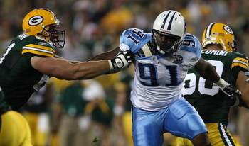 GREEN BAY, WI - AUGUST 28: Ryan Keenan #51 of the Green Bay Packers attempts to block Jason Jones #91 of the Tenessee Titans on August 28, 2008 at Lambeau Field in Green Bay, Wisconsin. The Titans defeated the Packers 23-21. (Photo by Jonathan Daniel/Gett