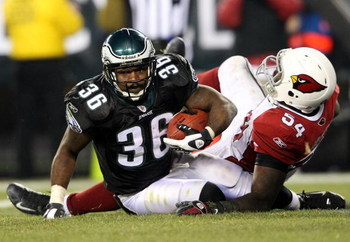 PHILADELPHIA - NOVEMBER 27:  Brian Westbrook #36 of the Philadelphia Eagles scores a touchdown despite the tackle from Gerald Hayes #54 of the Arizona Cardinals at Lincoln Financial Field on November 27, 2008 in Philadelphia, Pennsylvania.  (Photo by Nick