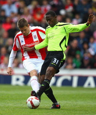 STOKE, ENGLAND - MAY 16:   James Beattie of Stoke is challenged by Maynor Figueroa of Wigan Athletic during the Barclays Premier League match between Stoke City and  Wigan Athletic at the Britannia Stadium on May 16, 2009 in Stoke, England.  (Photo by Mar